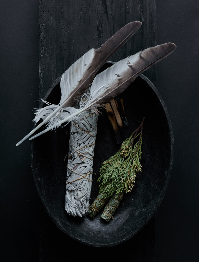 bowl of sage and feathers