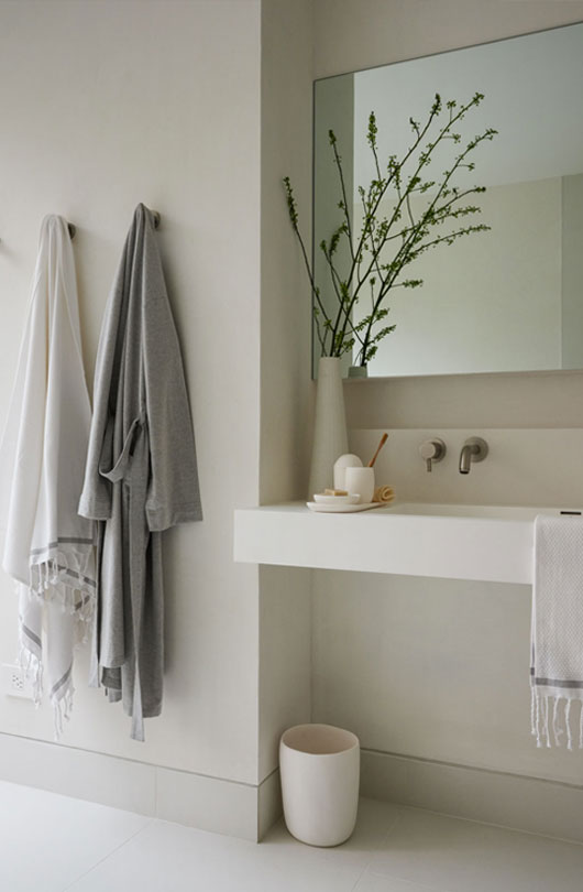 robes hanging next to bathroom sink
